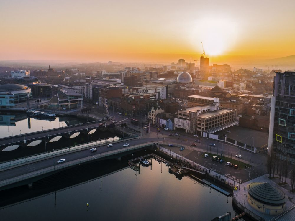 photo of Belfast from the air, with sunset