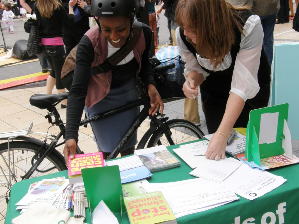 A woman visiting one of our local group stalls during the Big Ask campaign calling for a UK climate change law