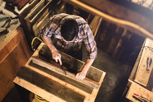 photo of man working with reclaimed wood