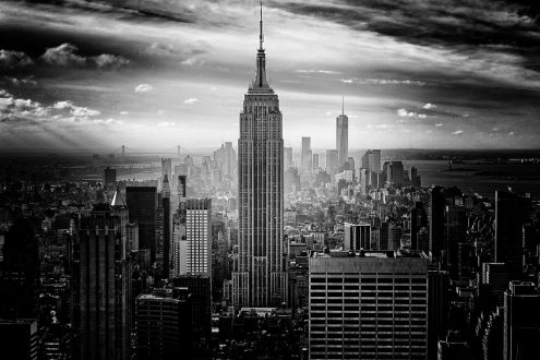 A black and white photo of New York city. The Empire State Building is prominent in the photo.