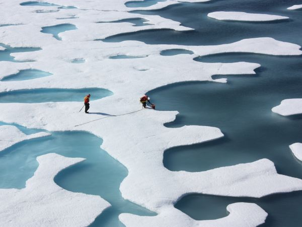 The sea ice atop the Arctic Ocean looking more like Swiss cheese or a bright coastal wetland. July 12, 2011