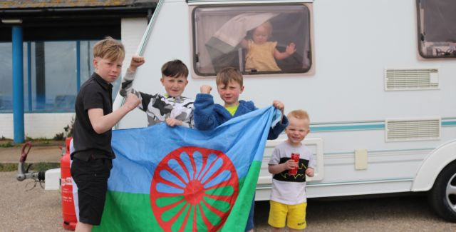 Children from a traveller community play in Hastings outside a caravan