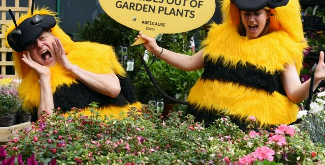 Friends of the Earth campaigners make the point about bee-harming pesticides at a garden centre