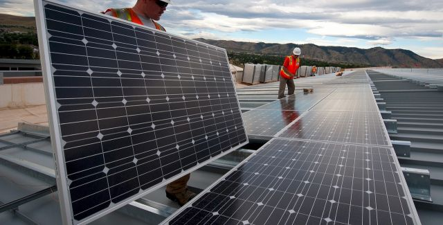 photo of engineers installing solar panels
